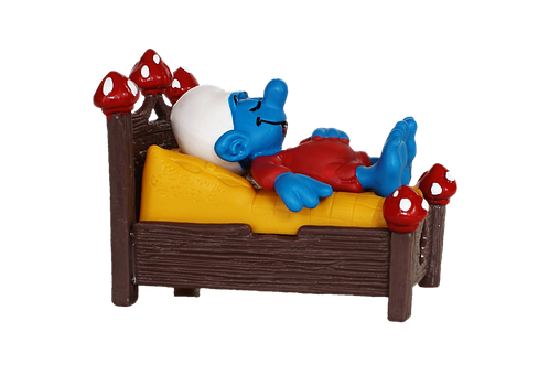 a happy back sleeping smurf on the right mattress for a back sleeper